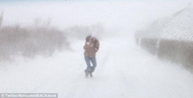 White out: This Nantucket resident ignores the warnings from government agencies to stay inside