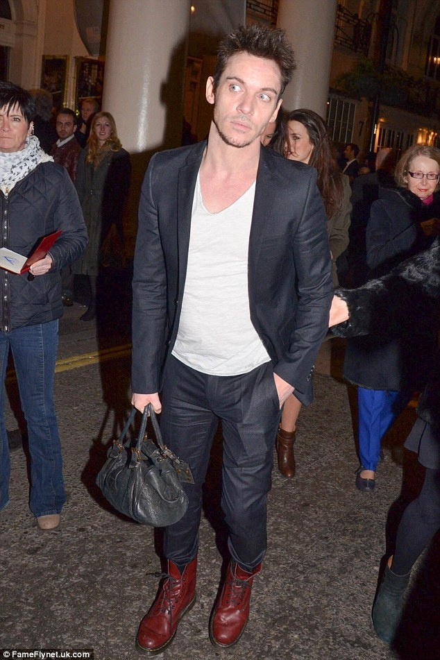 Is that your bag? Jonathan carried a handbag as he arrived at the theatre on Tuesday evening
