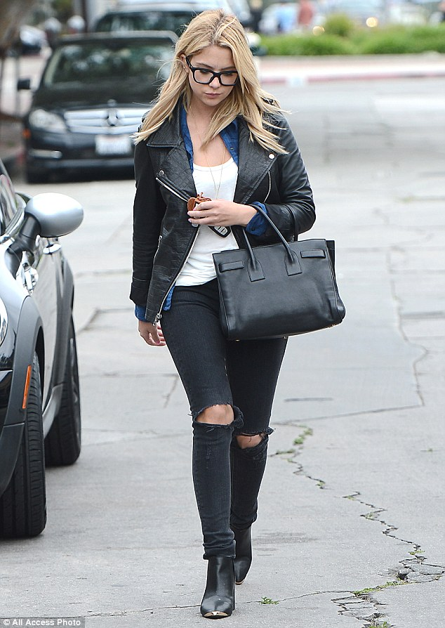 Hell for leather: Putting her slim figure on display as she headed out for a spot of retail therapy with her on-off beau, the blonde starlet teamed her vampy look with a simple white vest and a blue plaid button-down shirt, while toting a black leather handbag