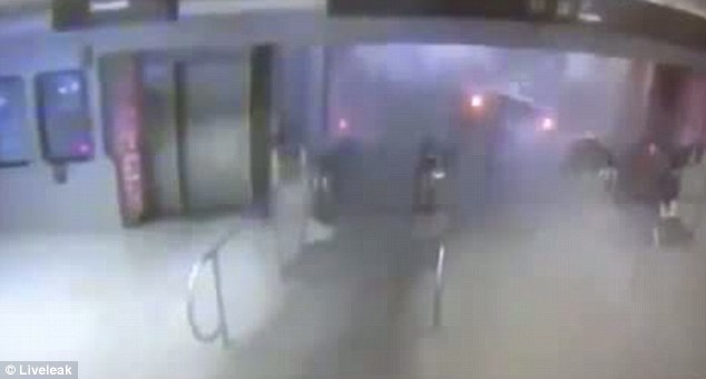 This picture shows the moment the train careered up a stairway believed to be at O'Hare International Airport
