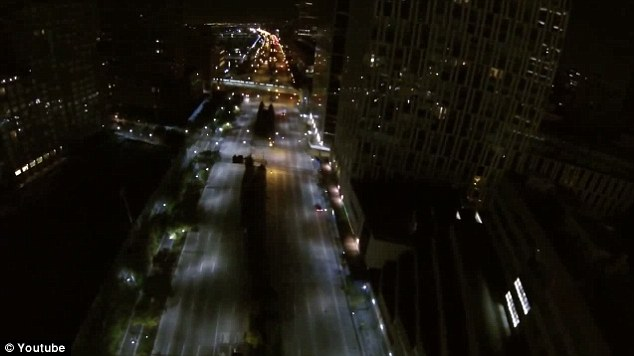 City that never sleeps: One of the jumpers descends on the streets of New York City