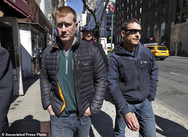 Confessed: James Brady, left, and Andrew Rossig, right, are accompanied by attorney Timothy Parlatore as they turn themselves in to police on Monday