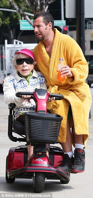 Alternative transport: Adam looked quite comfortable as he perched on the scooter while wearing a mustard yellow dressing gown