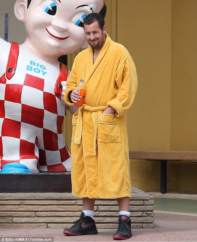 Caught in the act: Onlookers quickly flocked to Twitter to update on the actor as one user wrote: ¿Eating at Bob's Big Boy and Adam Sandler is outside filming for a movie'
