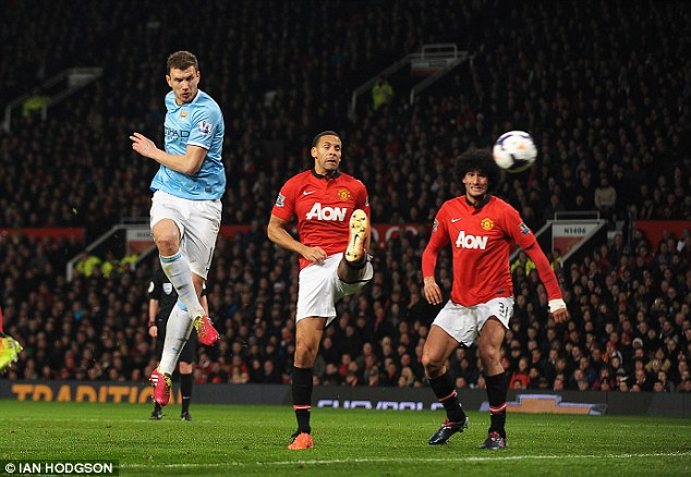Game, set and match: Edin Dzeko bags his second goal of the night in a dismal showing for United