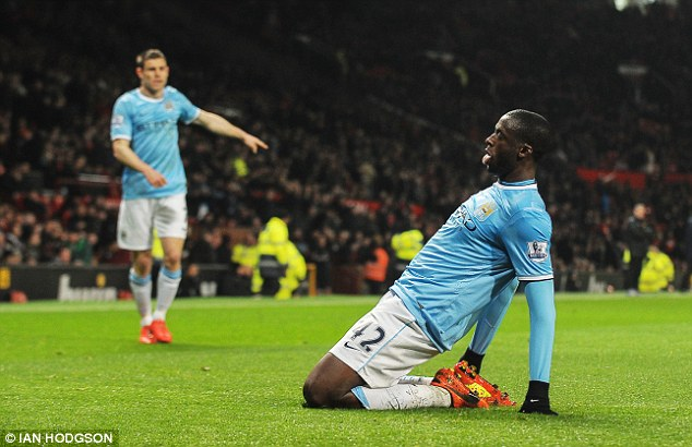 Salt in the wounds: Yaya Toure slides on his knees after rolling home Man City's third