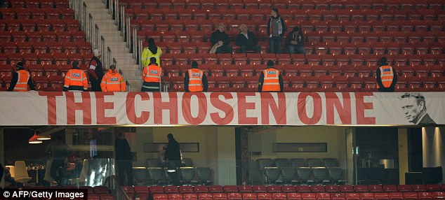 Keeping watch: The David Moyes banner will stay up at Old Trafford for now