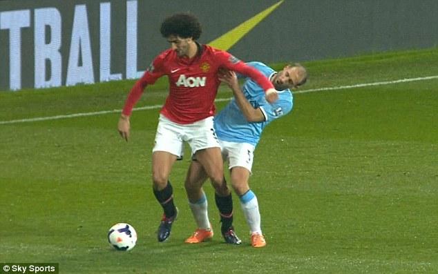 Accident: Fellaini has since said that Zabaleta ran into his elbow