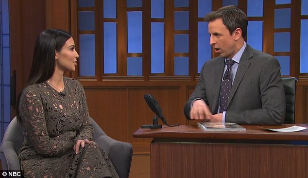 Raining on their parade: Kim Kardashian revealed baby North urinated on Kanye West as they shot their Vogue cover during an interview on The Late Show with Seth Meyers on Tuesday