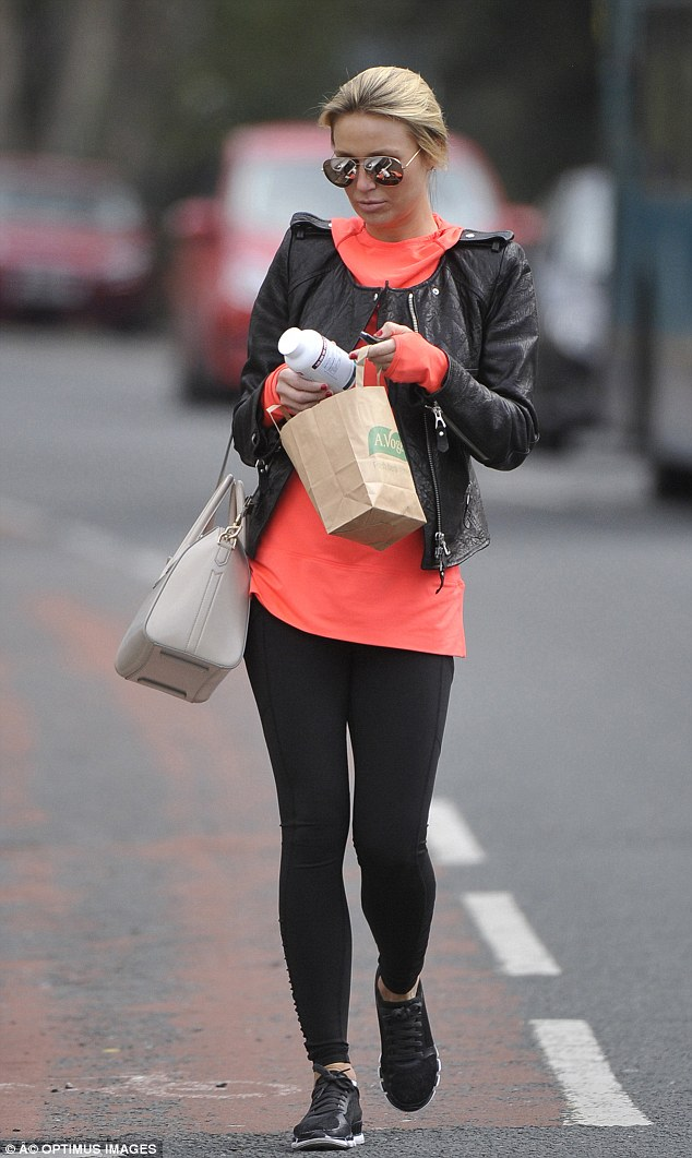 Stocking up on the good stuff: Alex Gerrard visits A. Vogel health food store in Liverpool and drops keys revealing the results of daily gym work-out