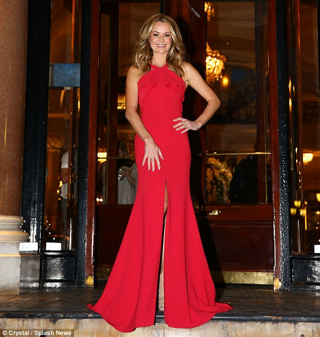 How about red? Amanda also wore a red halterneck gown at the glitzy bash
