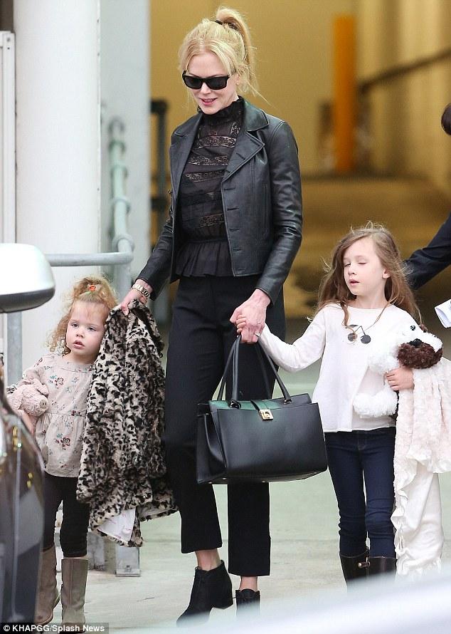 Little lookalikes: The girls have inherited their mum's strawberry blonde hair