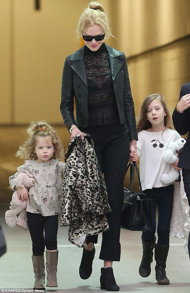 Back on Aussie soil: Nicole Kidman arrived in Sydney on Thursday with her daughters Sunday Rose and Faith Margaret
