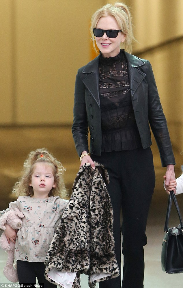 All smiles: Nicole had her girls by her side as she made her way through the airport