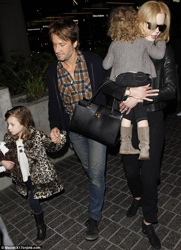 LAX airport: The family looked ready to jet back to Australia after a whirlwind visit to Los Angeles, where Nicole attended the funeral of L'Wren Scott and promoted her new film, The Railway Man