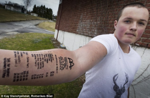 'Punishment': Stian Ytterdahl, 18, had been a little too successful with the ladies for his friends' liking and was ordered to tattoo the receipt from his trip to McDonald's