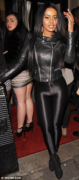 Skin-tight: Model Tabby Brown meanwhile undoubtedly turned heads in her spray-on leggings and biker jacket