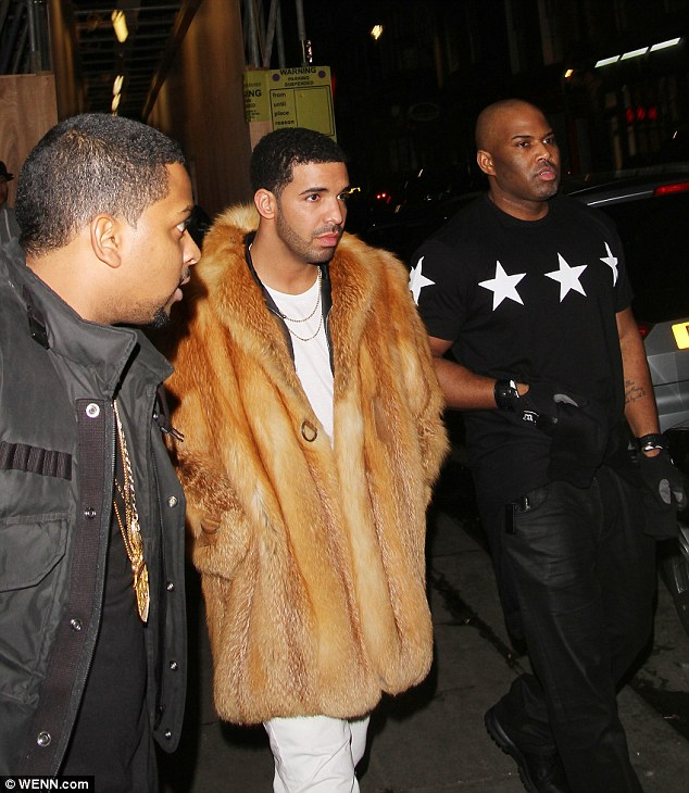 Calm before the storm: Dressed in bright white jeans and chunky Timerberland boots, Drake stood out amongst the sea of people thanks to a thick, brown fur coat