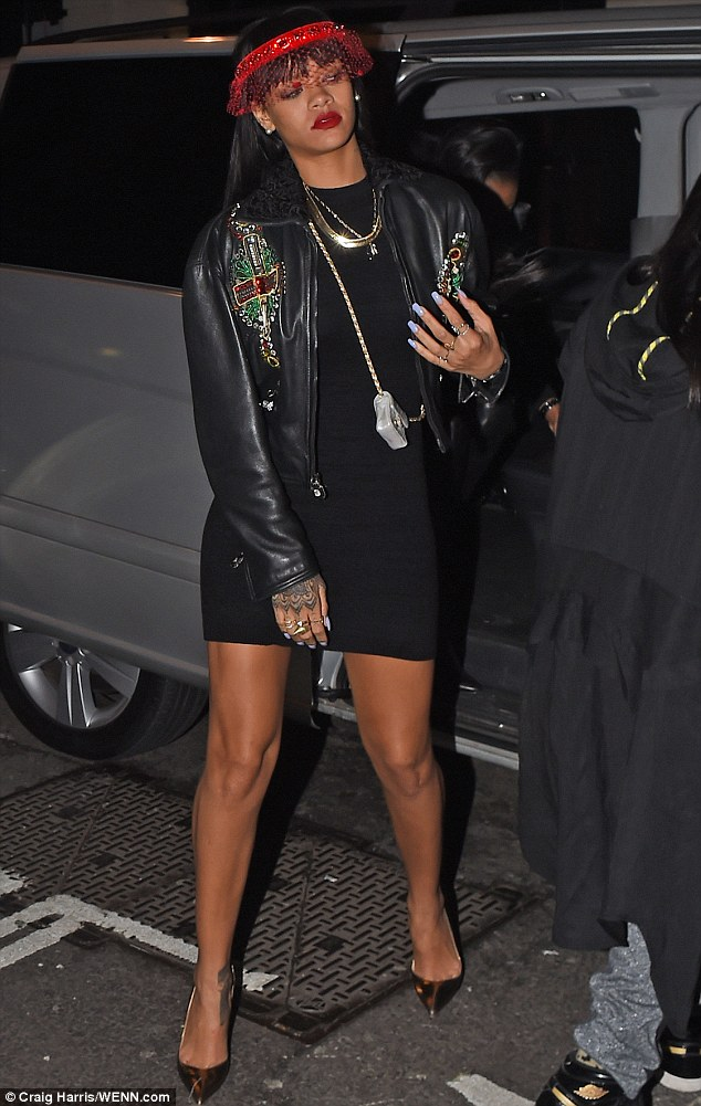 Going solo: Rihanna arrived to Tramps nightclub alone in a LBD and embellished leather jacket as Drake partied down the road