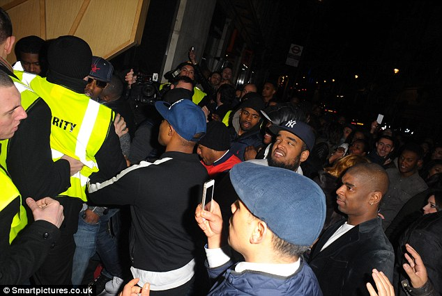 Commotion: After partying with pals including model Jourdan Dunn, the rapper caused a commotion amongst fans as he left DSTRKT just after 2am