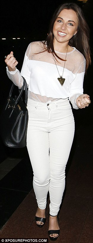 All white night: Louisa Lytton looked excited to be attending the Drake concert in London earlier in the night