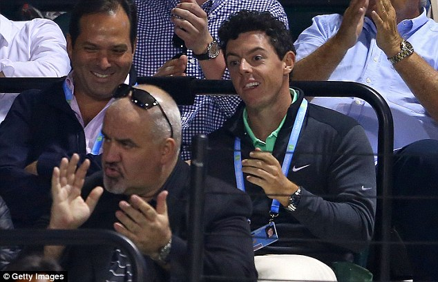 In the box: Wozniacki's fiance Rory McIlroy (right) watches the action at Crandon Park