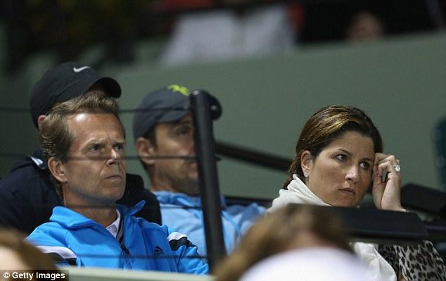 Tough viewing: Federer's coach Stefan Edberg (left) and wife Mirka watch the match
