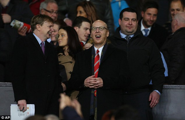 Lost interest? There is speculation the Glazer family, who own 90 per cent of the club, are willing to sell. Avram Glazer is pictured at the recent Champions League match with Olympiacos