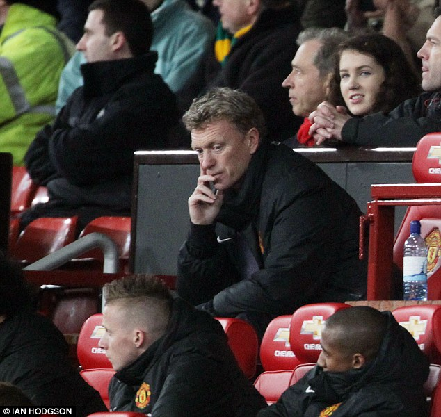Nowhere to hide: David Moyes cut a sorry figure on the bench as United slumped to a 3-0 defeat