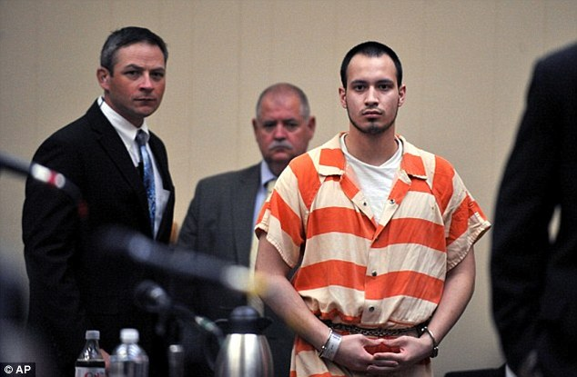 Money trail: An ex-girlfriend of Pvt. Isaac Aguigui, pictured at his preliminary hearing on August 30, 2012, testified that the soldier told her to expect 'a lot of money' just hours before his wife was suffocated to death leaving him to collect $500,000 in insurance
