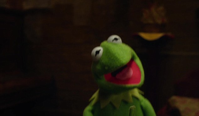 Bursting into song: Constantine is the spitting image of Kermit apart from the mole above his mouth, which is covered up on the film