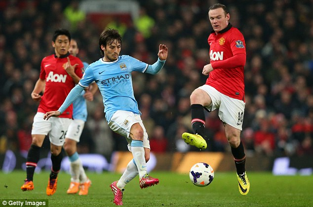 On the ball: The England international in action against Manchester City in Wednesday's crushing derby defeat