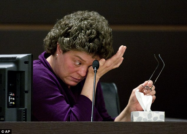 Secrets laid bare: Wife Pam Wyngarden cries as she takes the stand to testify against her husband on Tuesday, March 25, 2014