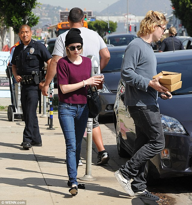 Keeping it casual: Evan pictured with Emma in Los Angeles last Thursday
