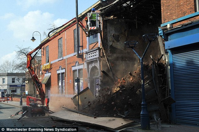 Crash: The former home of Victorian poet Francis Thompson collapses moments after an engineer removed a single brick