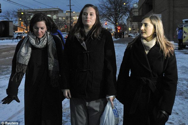 Jailed: Graham, pictured center last year, had wanted to withdraw her guilty plea, but the judge refused