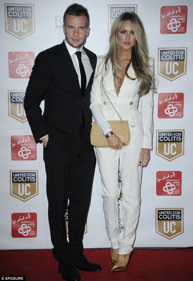 A bit of all white: Former TOWIE star Georgina Dorsett was yin to boyfriend Tom Cleverley's yang in black and white trouser suits