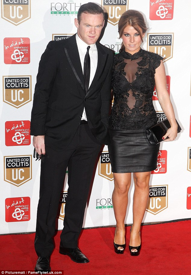 Sultry: Coleen Rooney went for a sexier style than normal in sheer lace top and leather mini as she joined husband Wayne Rooney at the United For Colitis charity dinner