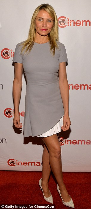 Unexpected detail: For her hosting duties, the always bubbly Cameron donned a grey short sleeve A-Line dress with a white pleated skirt that peaked out from under its asymmetrical hemline