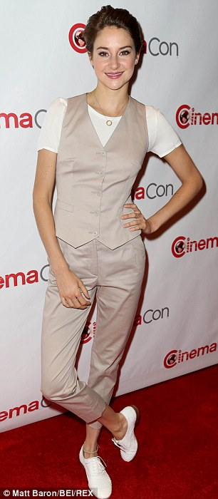 Well suited: The 22-year-old skipped a dress completely wearing a Dolce & Gabbana oatmeal pant suit featuring cropped pants and a vest over a white T-shirt