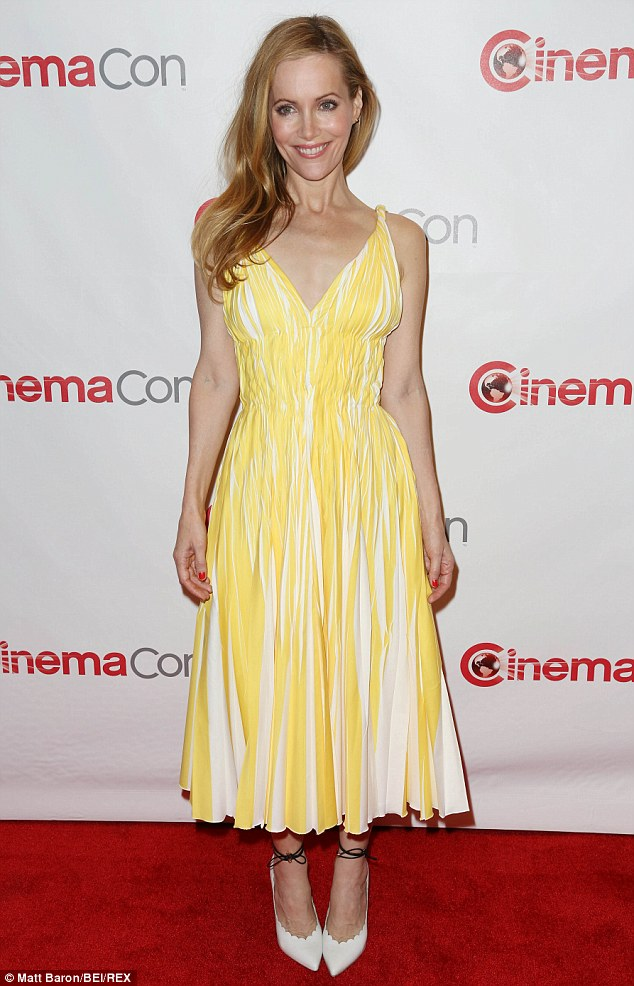 Shinning bright: For the presentation, the This Is 40 actress donned a long lemon and white dress that combined a pleated skirt with a ruched waistline, a triangle top and twisted straps