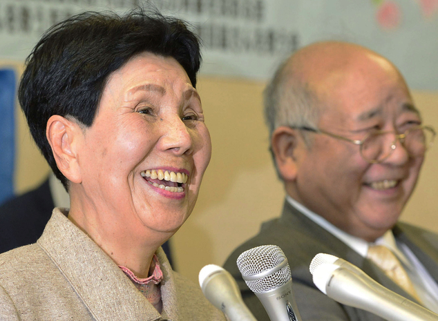 Hideko Hakamada (left) is pictured here at a press conference after the order for a retrial of her brother