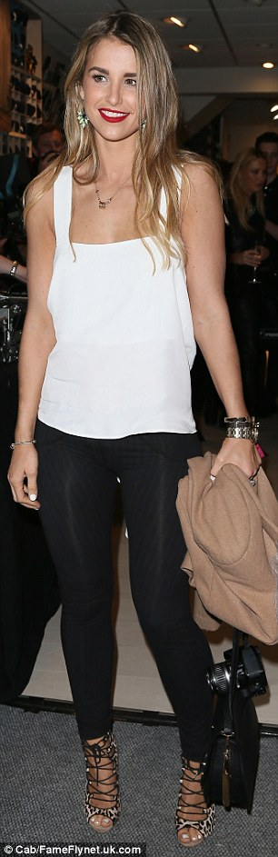 Bringing sexy back: Vogue McFadden had heads turning as she arrived at the Freddy store opening in London on Thursday in a sizzling white blouse with a low-cut back