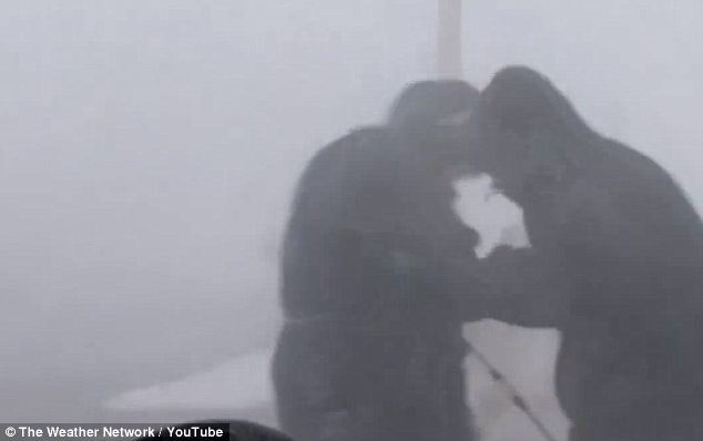 Powerful: The men are being blown off camera by wind gusts that exceeded 100MPH