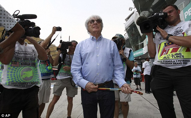 Making a noise: Bernie Ecclestone was in the paddock on Friday after missing the opening race of the season