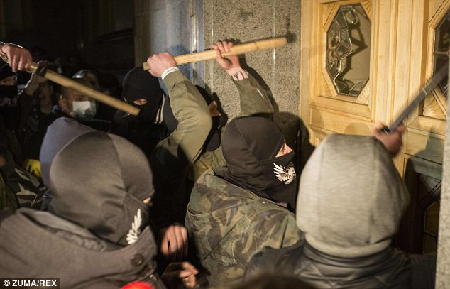 Revenge: Hundreds of members of the ultra-nationalist Right Sector movement stormed the parliament (Rada) building in Kiev last night, smashing windows and breaking down doors