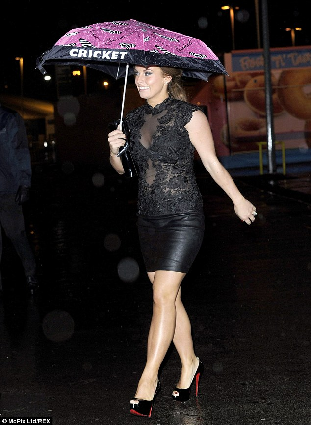 Showing support: Coleen sported an umbrella from her favourite boutique, as well as showing support for the charity event