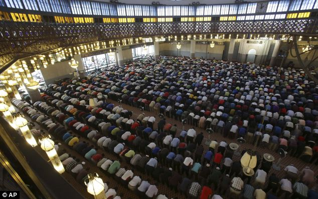 Prayers are said for passengers and crew of the missing Malaysia Airlines flight Mh370 during Friday prayers at a mosque in Kuala Lumpur