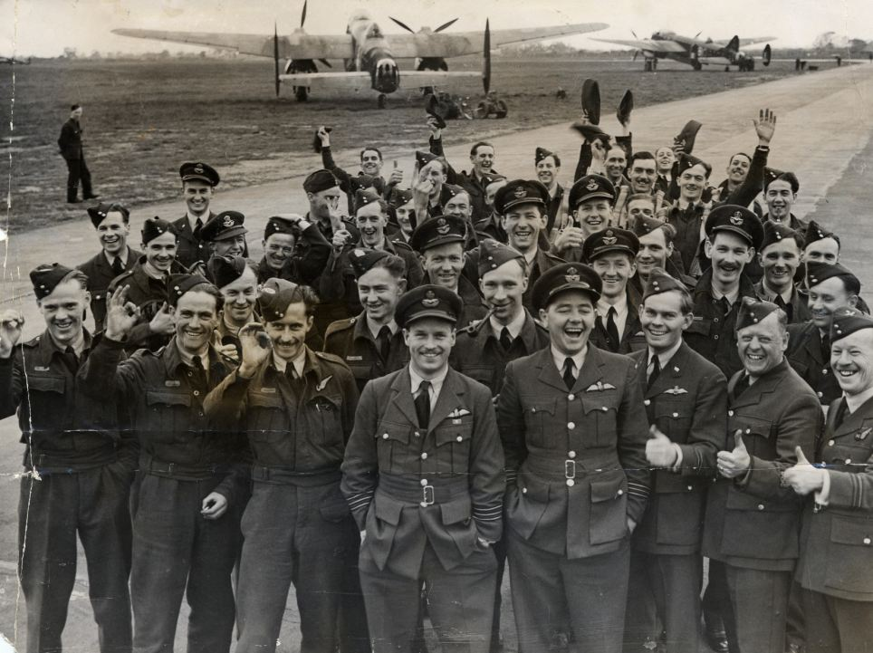RAF Bomber Command in World War II. Guy Gibson, centre, with the air crews who took part in the raid on Cologne. Guy Gibson won the Victoria Cross for his bravery during the Dambusters raid