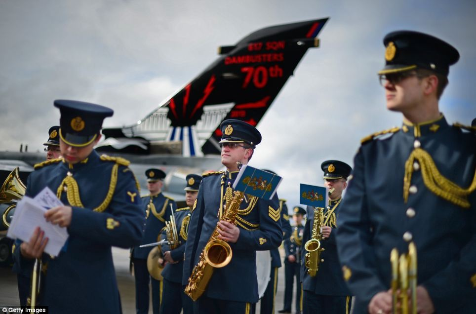 The band of the Royal Air Force join personnel from 617 squadron the Dambusters and their sister squadron 12 prepare to take part in a disbandment parade